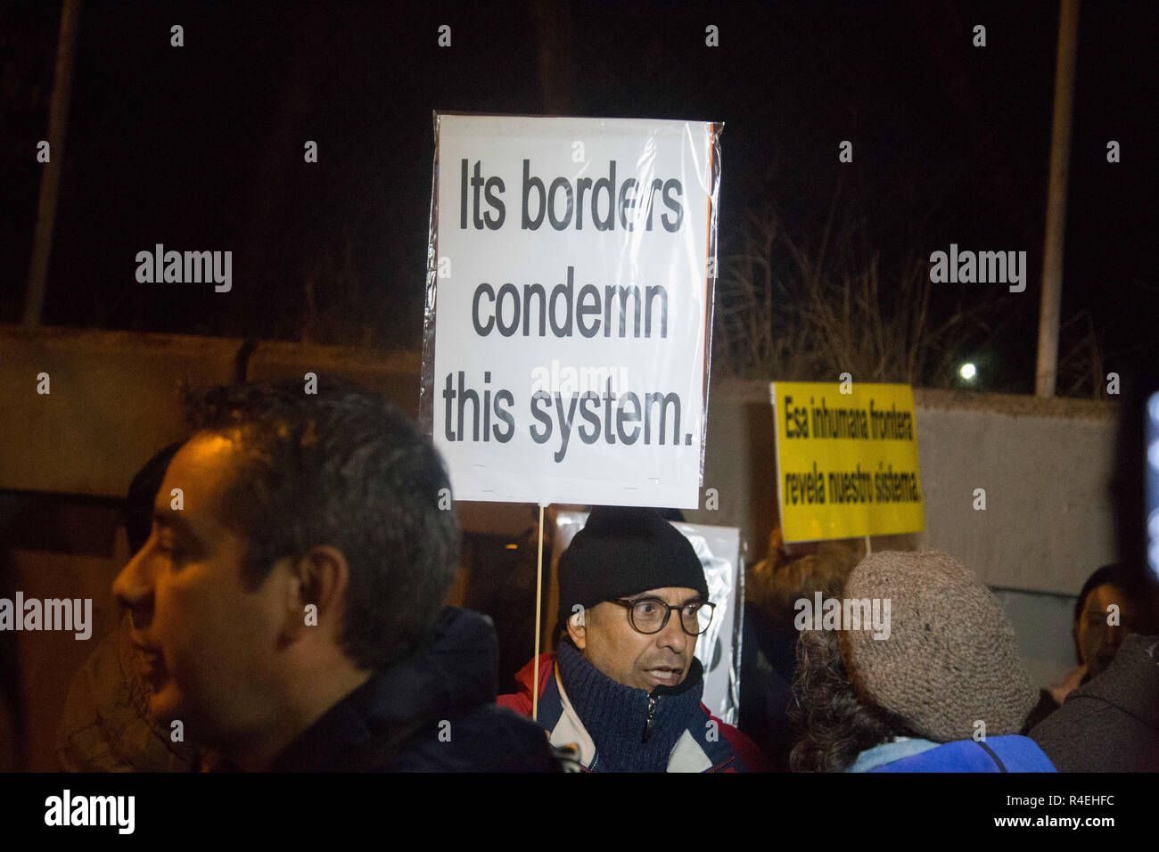 Madrid, Spain. 27th Nov, 2018. A protester seen holding a placard during the protest.Demonstration was held in front of the Immigration Detention Centre to demand for the closure of this centre and the rest in Europe for treating undocumented immigrants as criminals, depriving them of freedom, against Human Rights and for the racist treatment in them. Credit: Lito Lizana/SOPA Images/ZUMA Wire/Alamy Live News - Stock Image