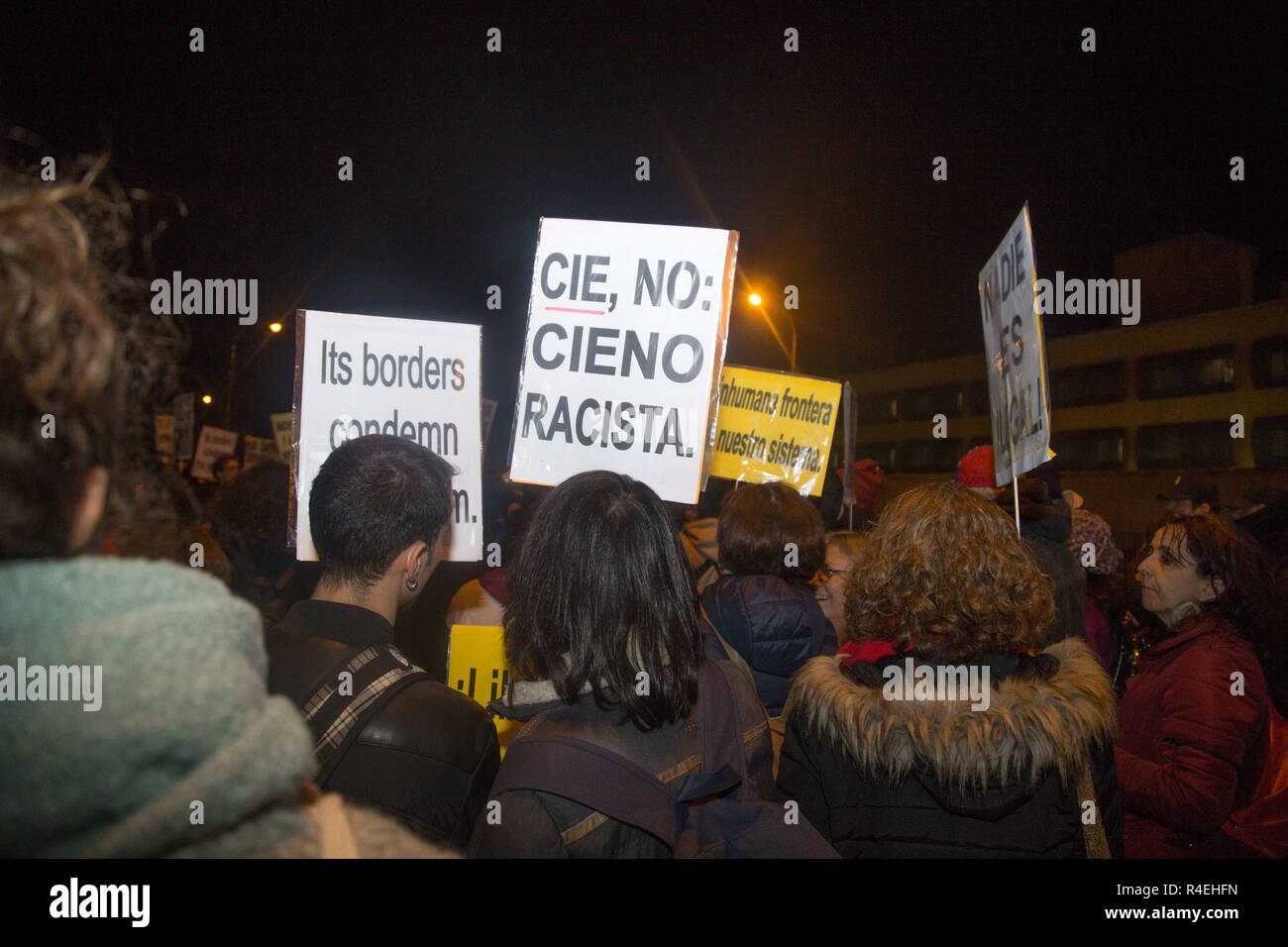 Madrid, Spain. 27th Nov, 2018. Protesters are seen holding placards during the protest.Demonstration was held in front of the Immigration Detention Centre to demand for the closure of this centre and the rest in Europe for treating undocumented immigrants as criminals, depriving them of freedom, against Human Rights and for the racist treatment in them. Credit: Lito Lizana/SOPA Images/ZUMA Wire/Alamy Live News - Stock Image