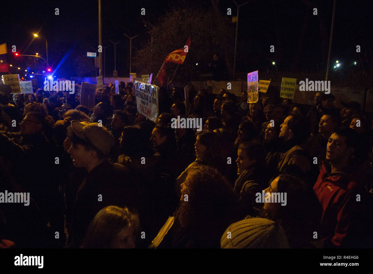 Madrid, Spain. 27th Nov, 2018. Hundreds of protesters are seen gathered in front of the Aluche Immigrant Detention Centre during the protest.Demonstration was held in front of the Immigration Detention Centre to demand for the closure of this centre and the rest in Europe for treating undocumented immigrants as criminals, depriving them of freedom, against Human Rights and for the racist treatment in them. Credit: Lito Lizana/SOPA Images/ZUMA Wire/Alamy Live News - Stock Image