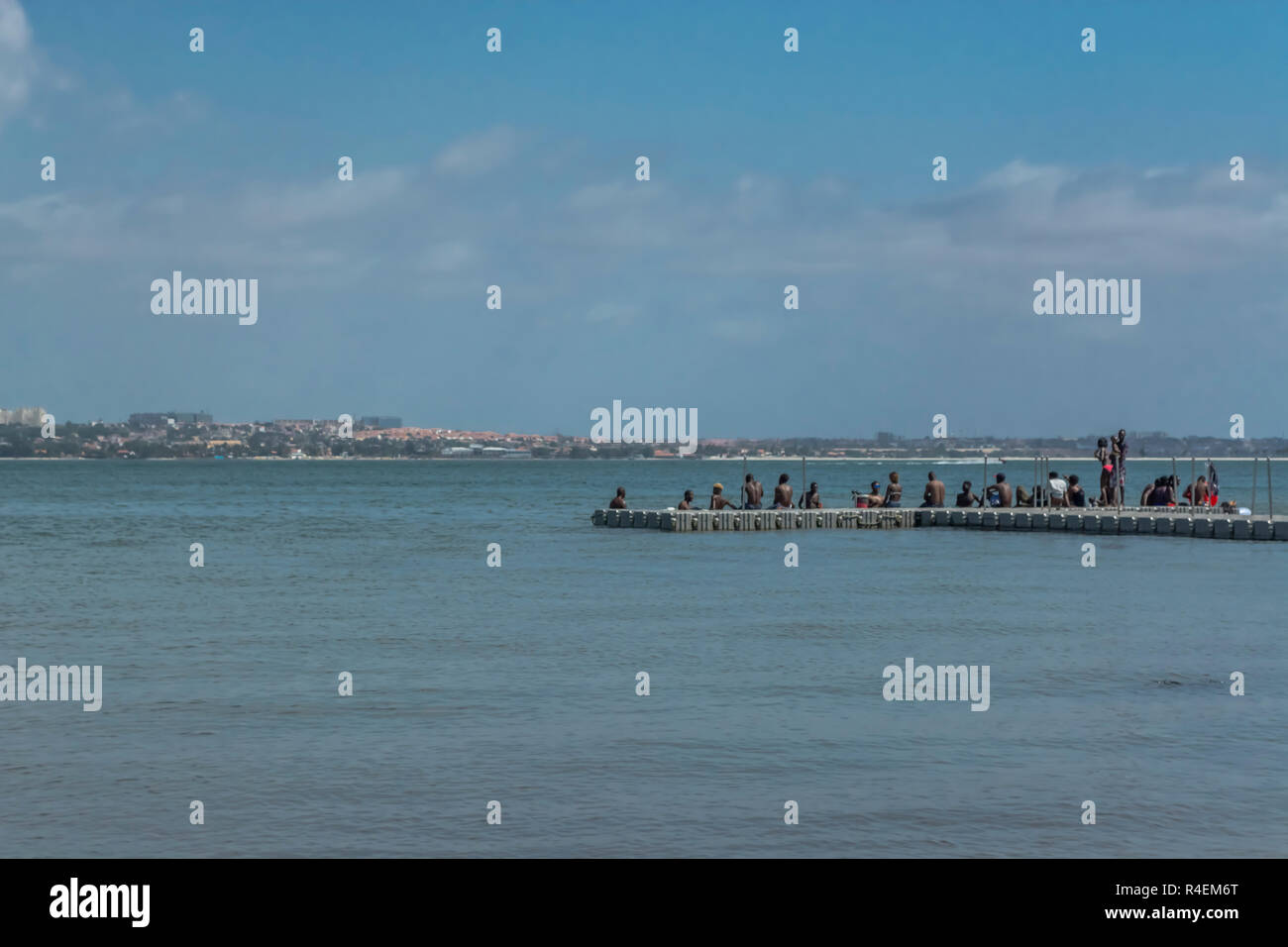 Luanda/Angola - 11 11 2018: View of small dock with people over, sea and jet boat, on the coast of Mussulo island, in Luanda, Angola - Stock Image