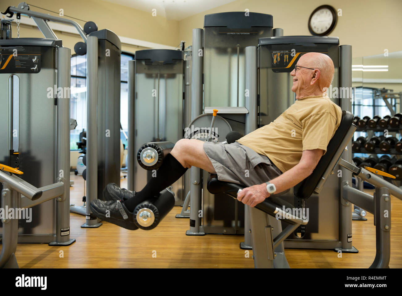 An Active Senior Male Working Out In The Gym - Stock Image