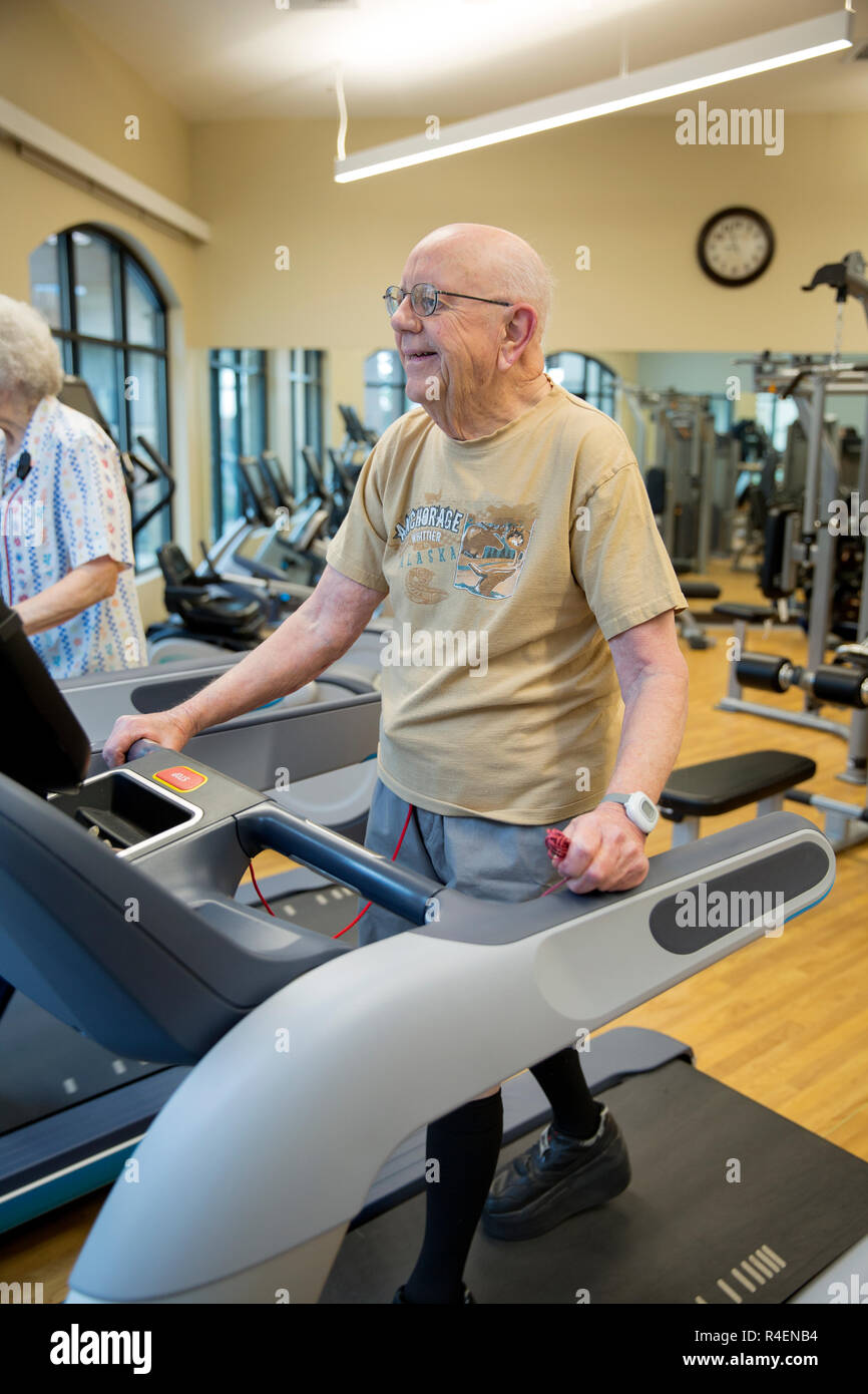 Old Man Working Out In Gym - Stock Image