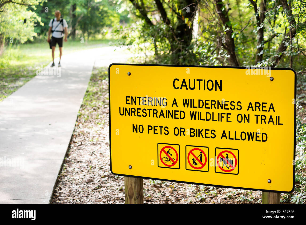 Gainesville, USA - April 27, 2018: Paynes Prairie Preserve State Park Watershed Wilderness area sign in Florida with information on trail hike, man ph - Stock Image