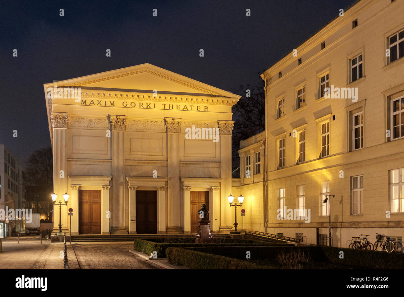 Germany, Berlin Mitte, Am Festungsgraben - Maxim Gorki Theater at night- a contemporary drama venue with a studio. - Stock Image