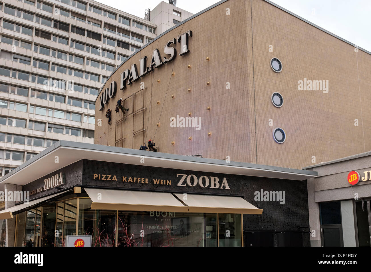 Germany,Berlin, Zoo Palast Movie Theatre- workers preparing the cinema facade for the Berlinale- Internation Cinema Festival - Stock Image