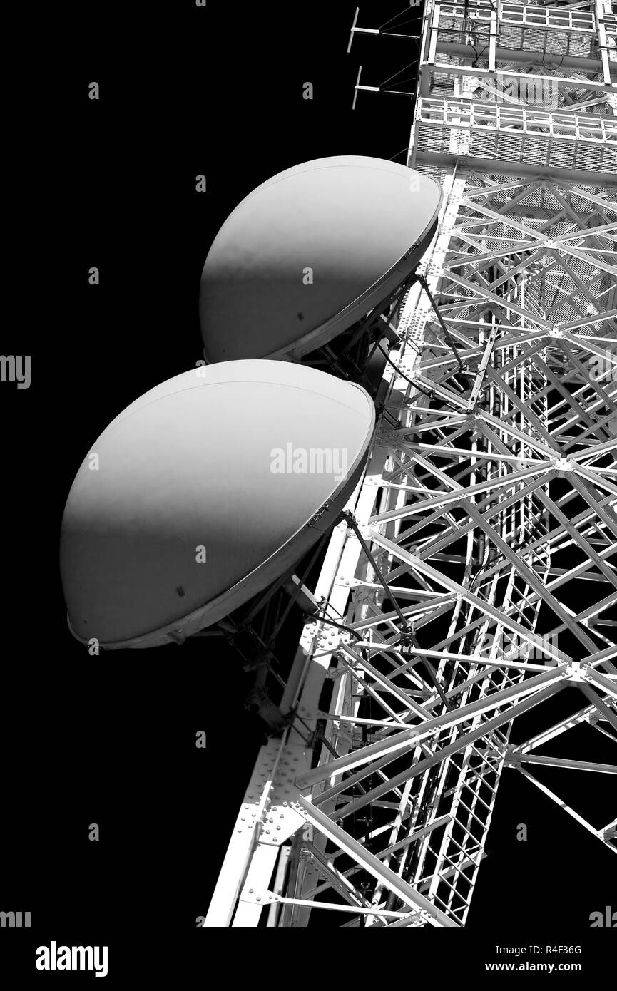 Red and white tower of communication with their antennas - Black and white conversion - Stock Image