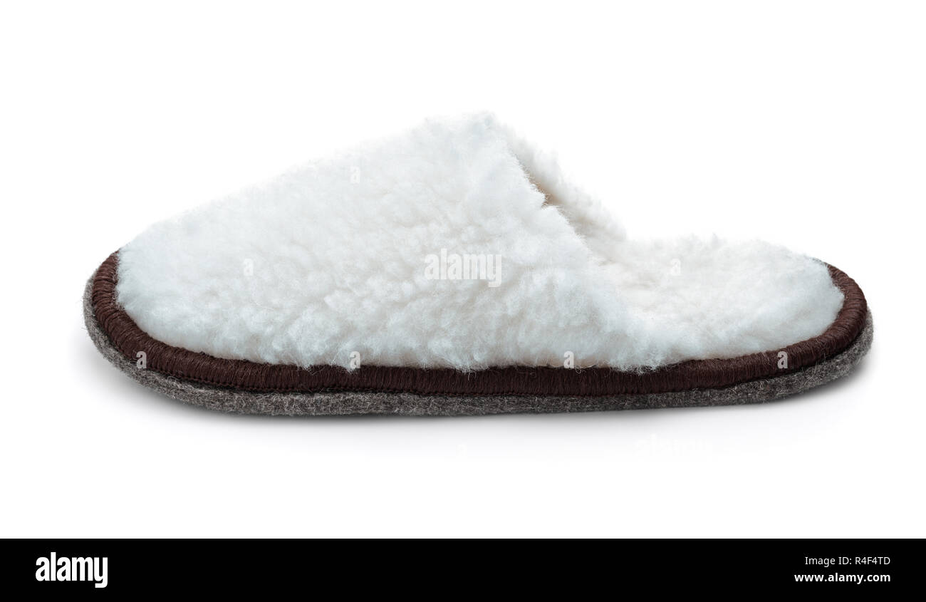Side view of single white fur slipper isolated on white - Stock Image