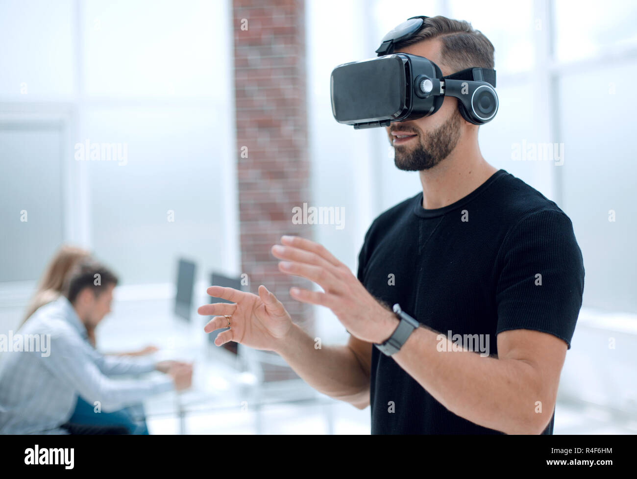 Male handsome patient with modern VR goggles - Stock Image