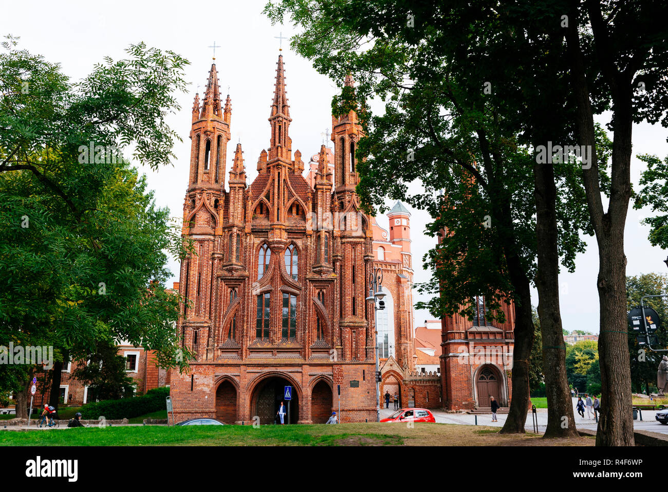 Facade of St. Anne's Church is a Roman Catholic church in Vilnius Old Town. It is a prominent example of both Flamboyant Gothic and Brick Gothic style - Stock Image