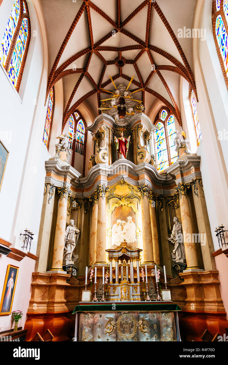 Main altar, St. Anne's Church is a Roman Catholic church in Vilnius Old Town. It is a prominent example of both Flamboyant Gothic and Brick Gothic sty - Stock Image