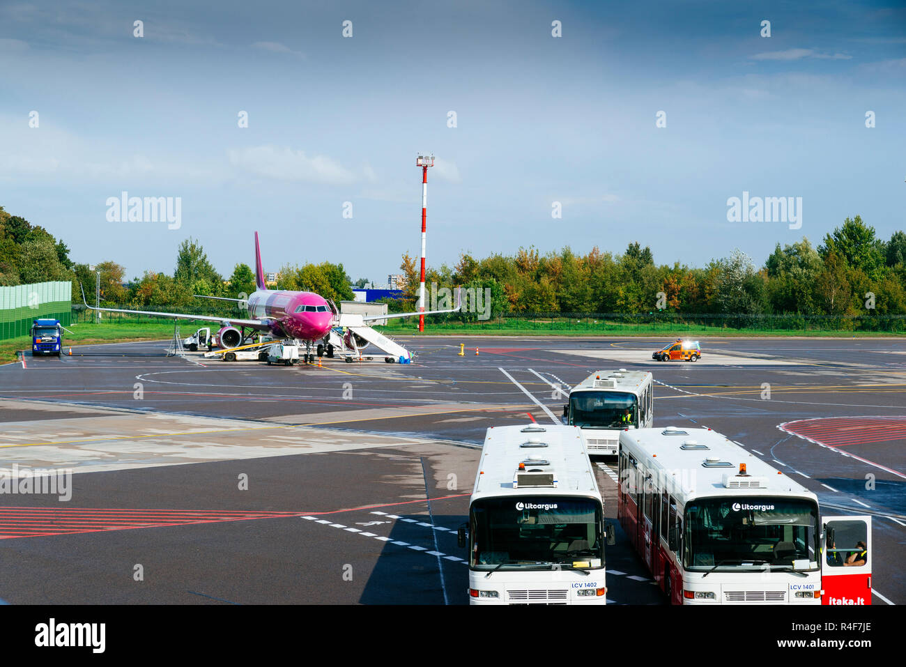 landed plane, Wizz Air,Hungarian low-cost airline, in the Vilnius Airport. Vilnius, Vilnius County, Lithuania, Baltic states, Europe. - Stock Image