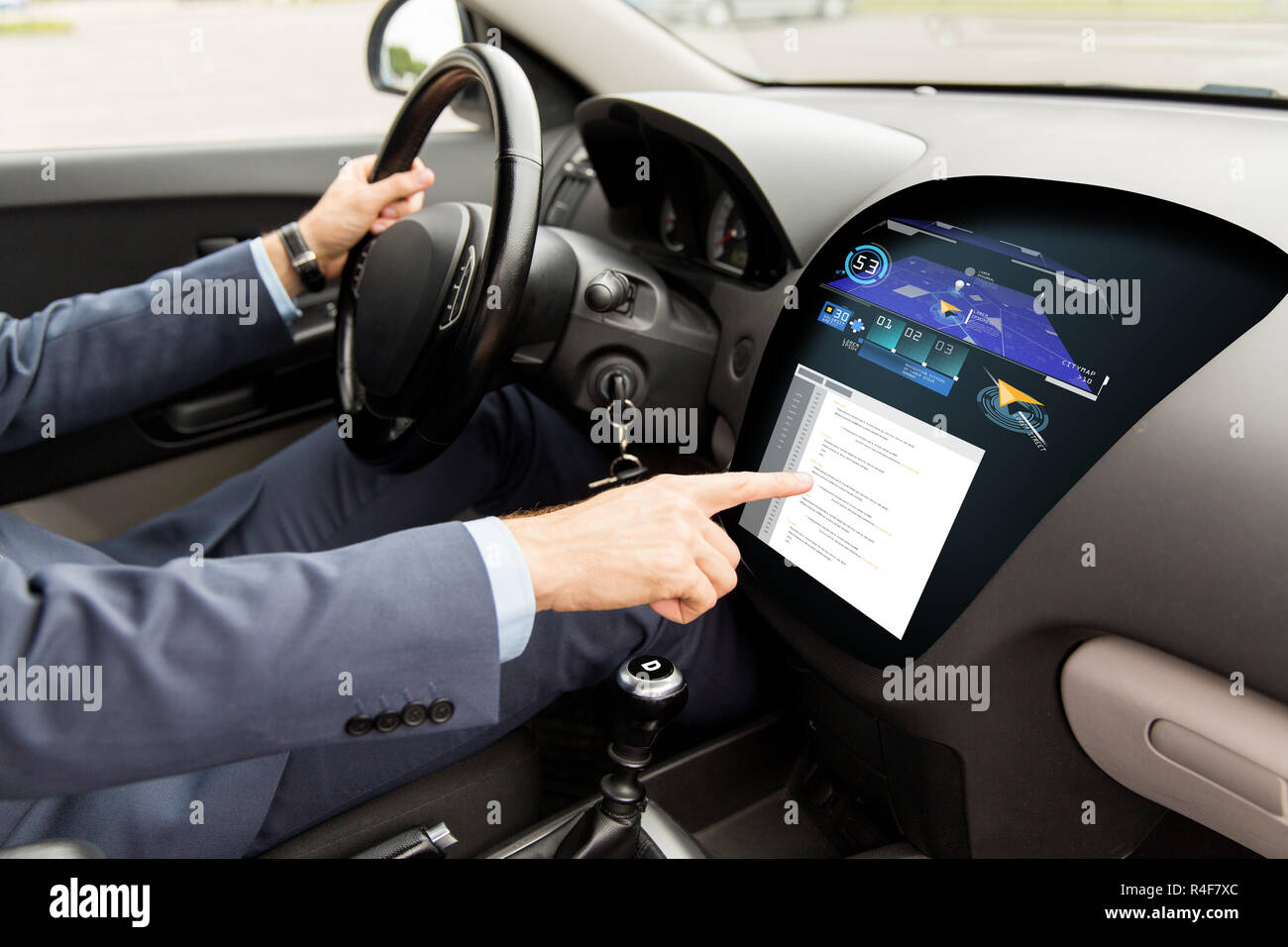 close up of man driving car with navigation system Stock Photo
