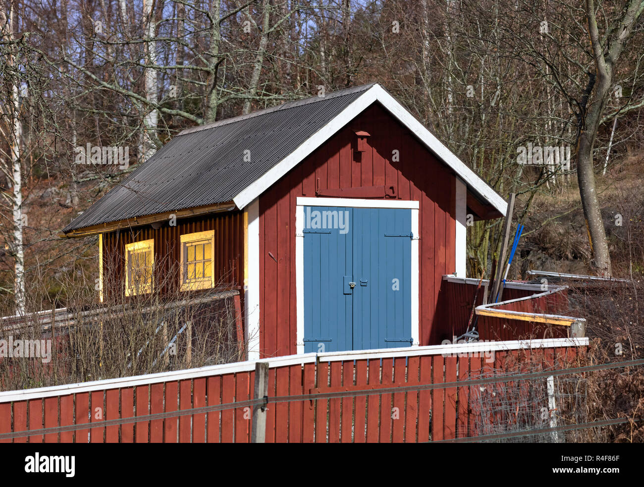 Wooden barn in moon shine in Sweden - Stock Image