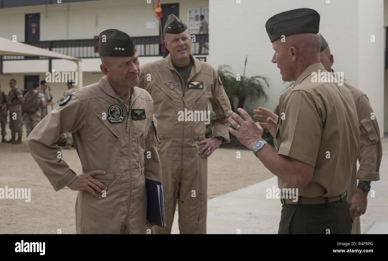 From left to right, U.S. Marine Corps Lt. Gen. Jon Davis, deputy commandant for aviation, Maj. Gen. Mark Wise, 3rd Marine Aircraft Wing (MAW) commanding general, are greeted by Col. Richard Fuerst, commanding officer of Marine Corps Air Station (MCAS) Iwakuni, Japan, at MCAS Yuma, Ariz. Oct. 24, 2016. This event gave Yoshihiko Fukuda, mayor of Iwakuni City, Japan, an idea of what to expect of the aircraft following the scheduled basing of Marine Fighter Attack Squadron (VMFA) 121 at MCAS Iwakuni. After its transition, VMFA-121 will be the first F-35B squadron stationed in Japan. Stock Photo