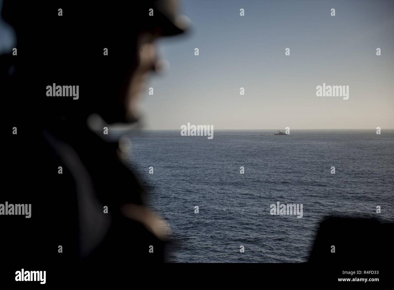 PACIFIC OCEAN (May 2, 2017) Gunners Mate Seaman Nathaniel Carnley, a Houston native, assigned to the Operations Department of amphibious dock landing ship USS Pearl Harbor (LSD 52), stands watch during a  routine transit off the coast of Southern CaliforniaSouthern California Presence Operations Transit (SPO-T) on the ship's forecastle. 1,800 Sailors and 2,600 Marines assigned to the America Amphibious Ready Group (ARG) and the 15th Marine Expeditionary Unit (MEU) are currently conducting a Composite Unit Training Exercise (COMPTUEX) off the coast of Southern California in preparation for the  - Stock Image