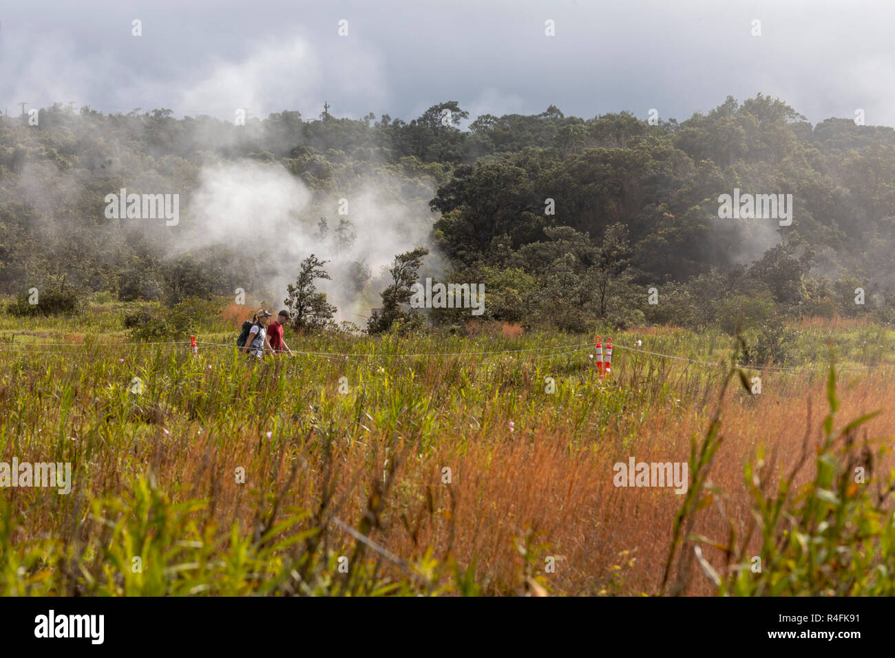 Hawaii Volcanoes National Park, Hawaii - Hikers near steam vents from the Kilauea volcano. - Stock Image