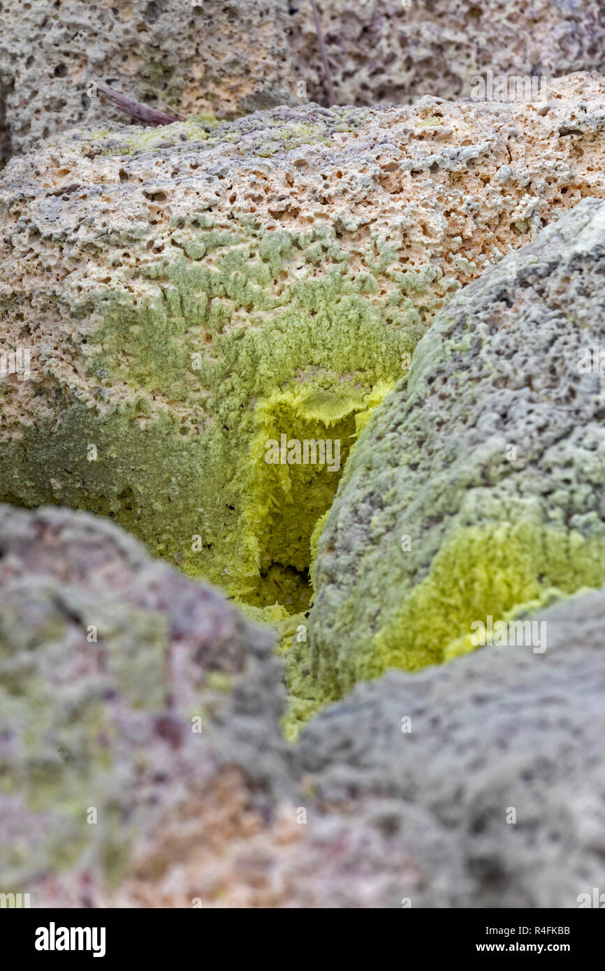 Hawaii Volcanoes National Park, Hawaii - Crystals of pure sulfur at the sulphur banks near the Kilauea volcano. Sulfur dioxide (SO2) and and hydrogen  - Stock Image