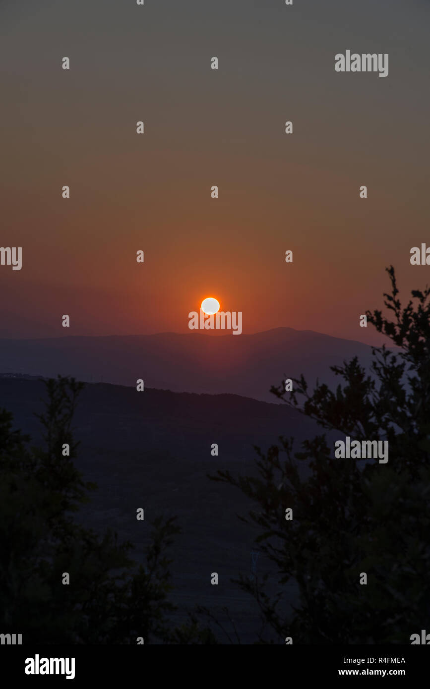 Sunset in the mountains - Stock Image