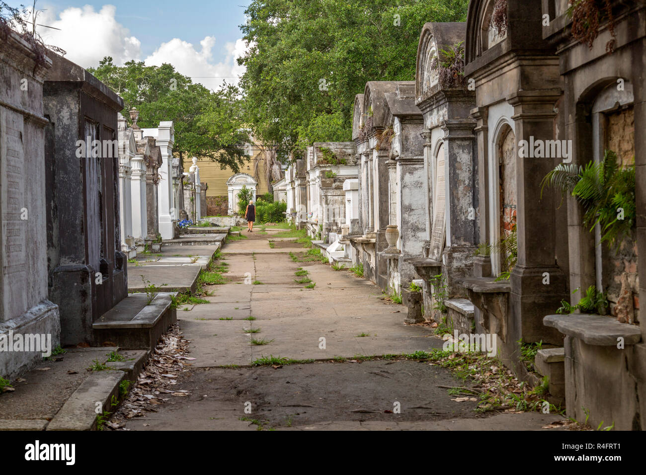 Woman wanders through the historic St  Louis cemetery, in New