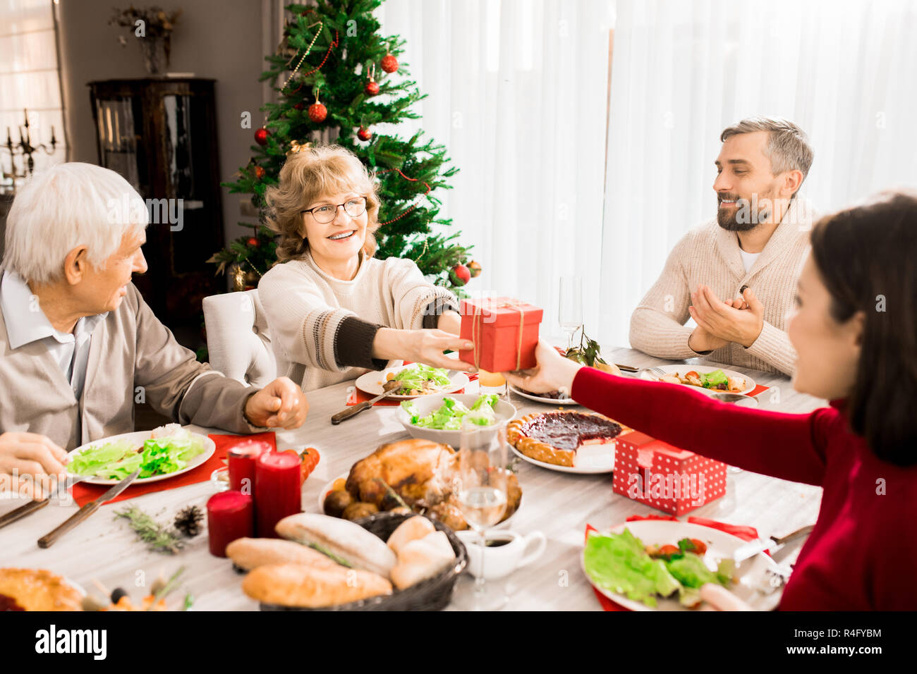 Family Exchanging Presents - Stock Image