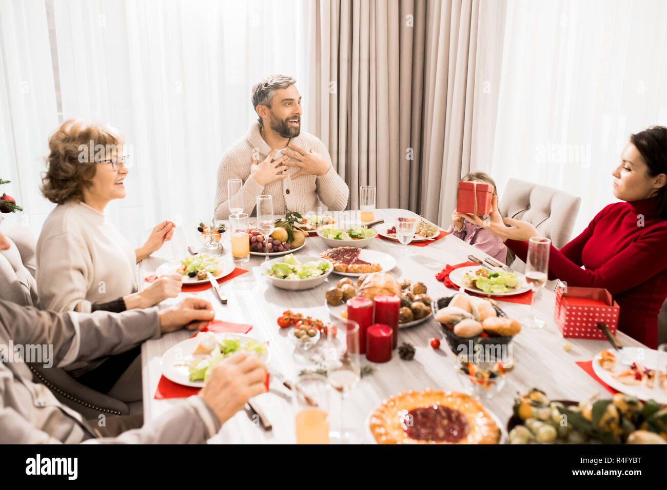 Family Exchanging Christmas Presents - Stock Image
