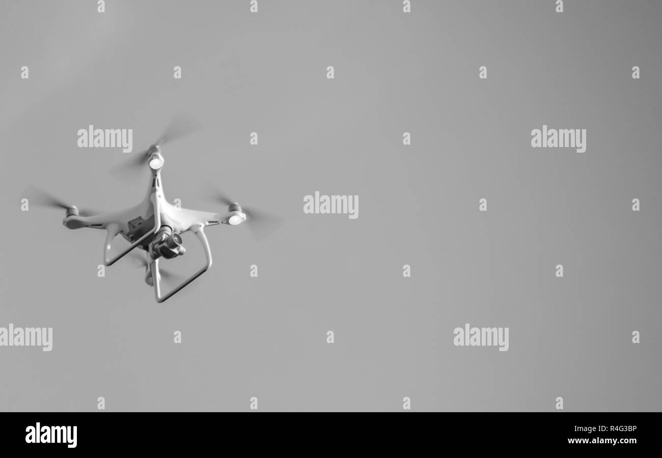 The drone, hovering in the sky. Flight quadrocopters - Stock Image