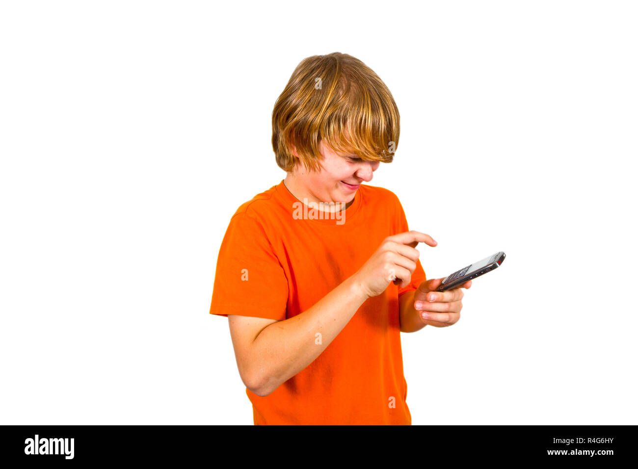 boy is using the mobile - Stock Image