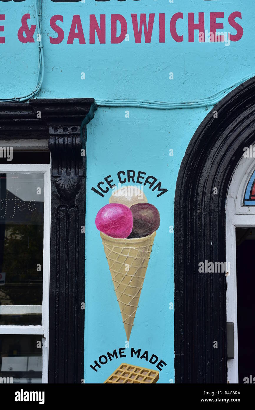 Blue facade with black wooden window frames of home made icecream and sandwiches shop in Kilkenny. - Stock Image