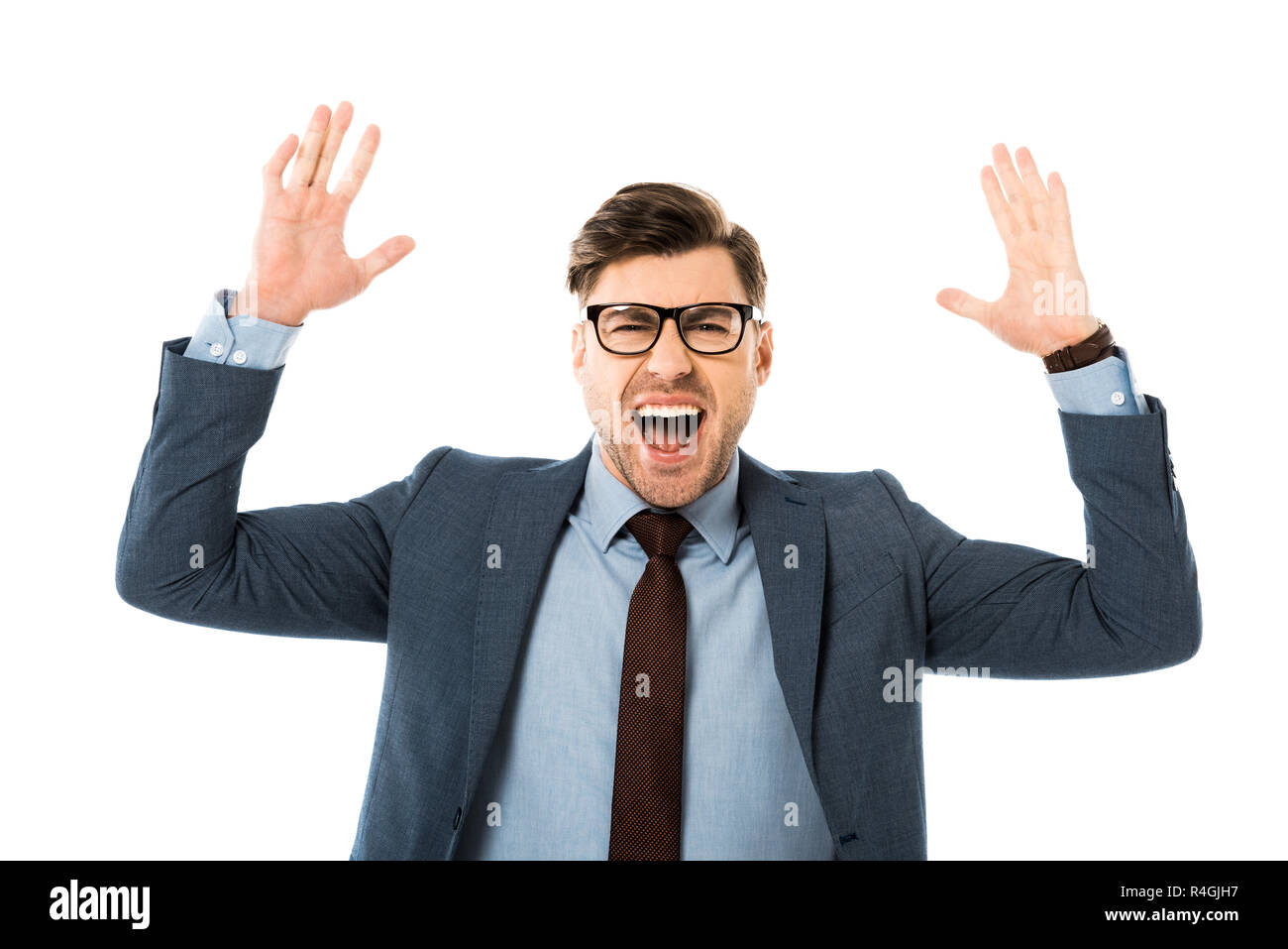 emotional businessman in suit rejoicing and gesturing isolated on white Stock Photo