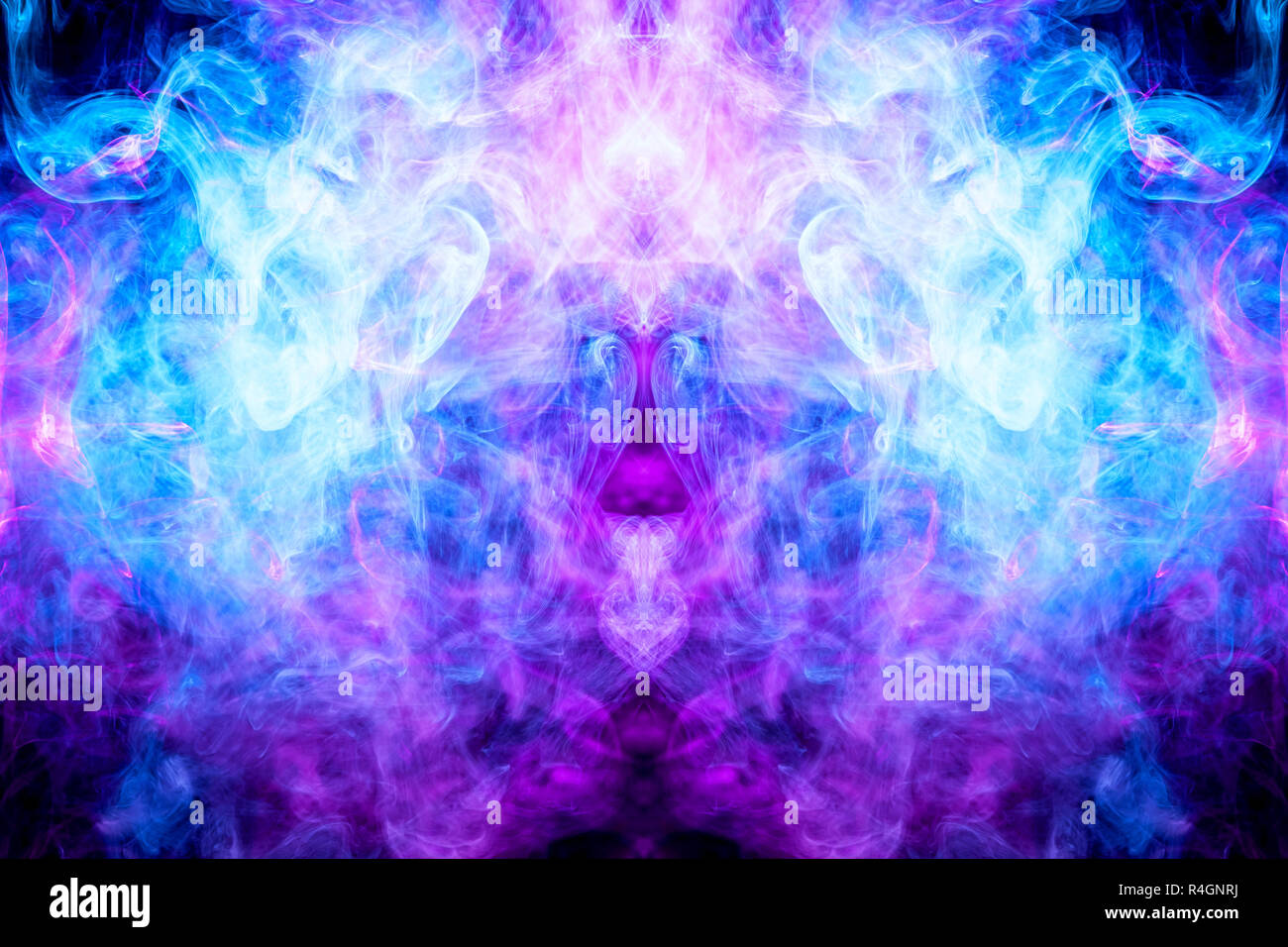 Pink And Blue Cloud Of Smoke Of Black Isolated Background In The