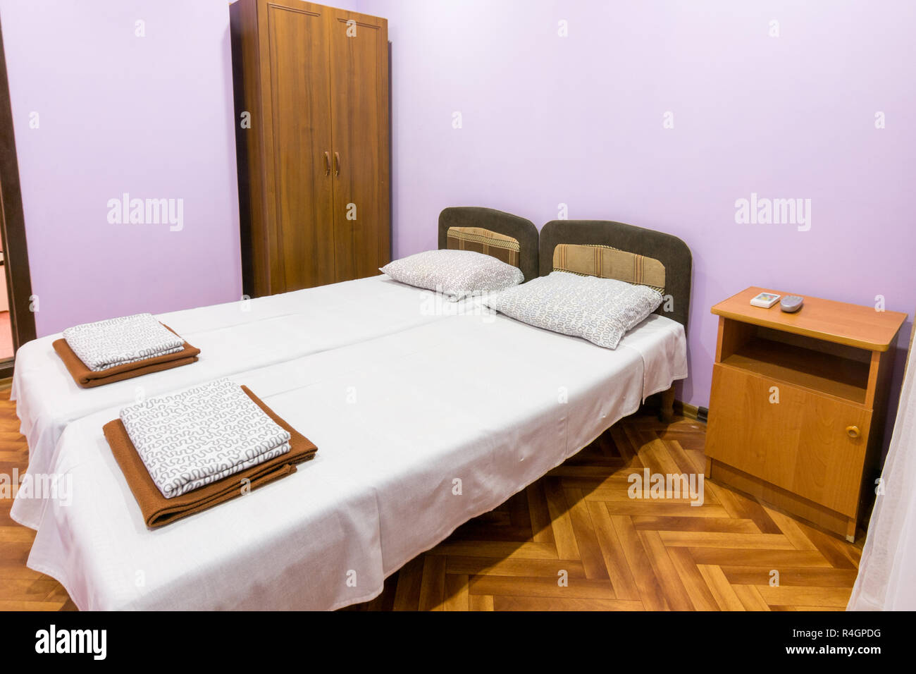 The Interior Of A Small Room With A Double Bed A Bedside Table And