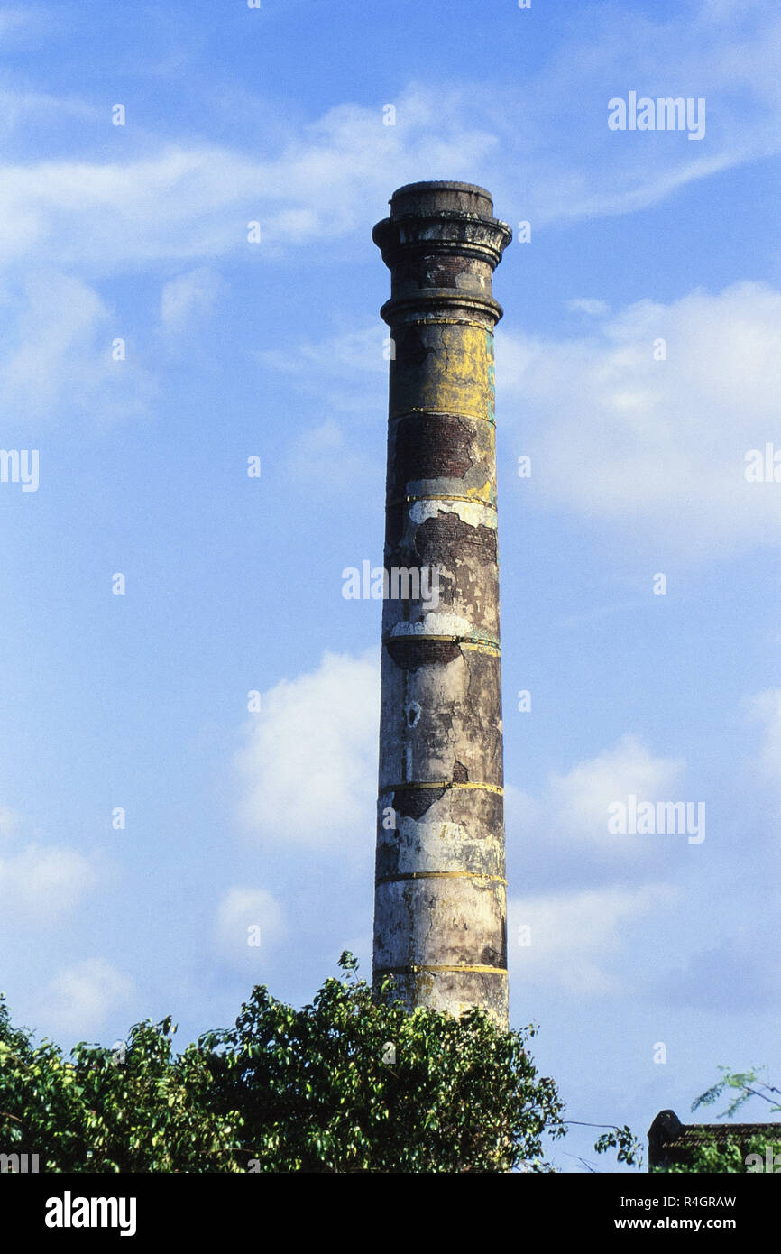 Cotton mill chimney in poor condition, Mumbai, India, Asia - Stock Image