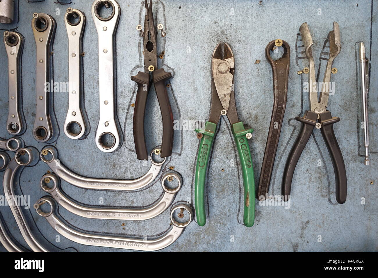 Tools, various spanners and pliers in a car repair shop, Germany - Stock Image