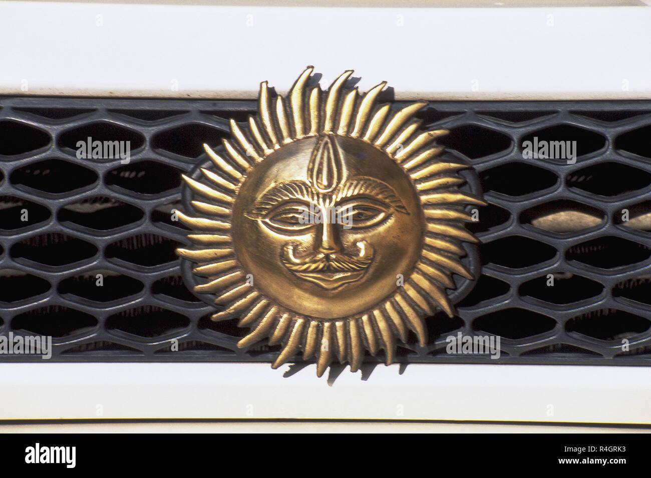 Emblem of sun on car dash, Mumbai, India, Asia - Stock Image