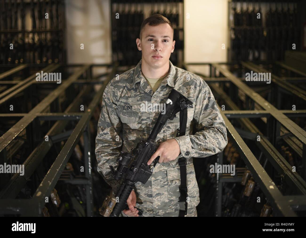 U.S. Air Force Airman 1st Class Nicholas Terry, 100th Security Forces Squadron armorer, poses for a photo at RAF Mildenhall, England, Sept. 25, 2018. Airmen assigned to the armory are responsible for arming and de-arming security forces Airmen during each shift change, as well as ensuring issued weapons are being cleaned properly. Stock Photo