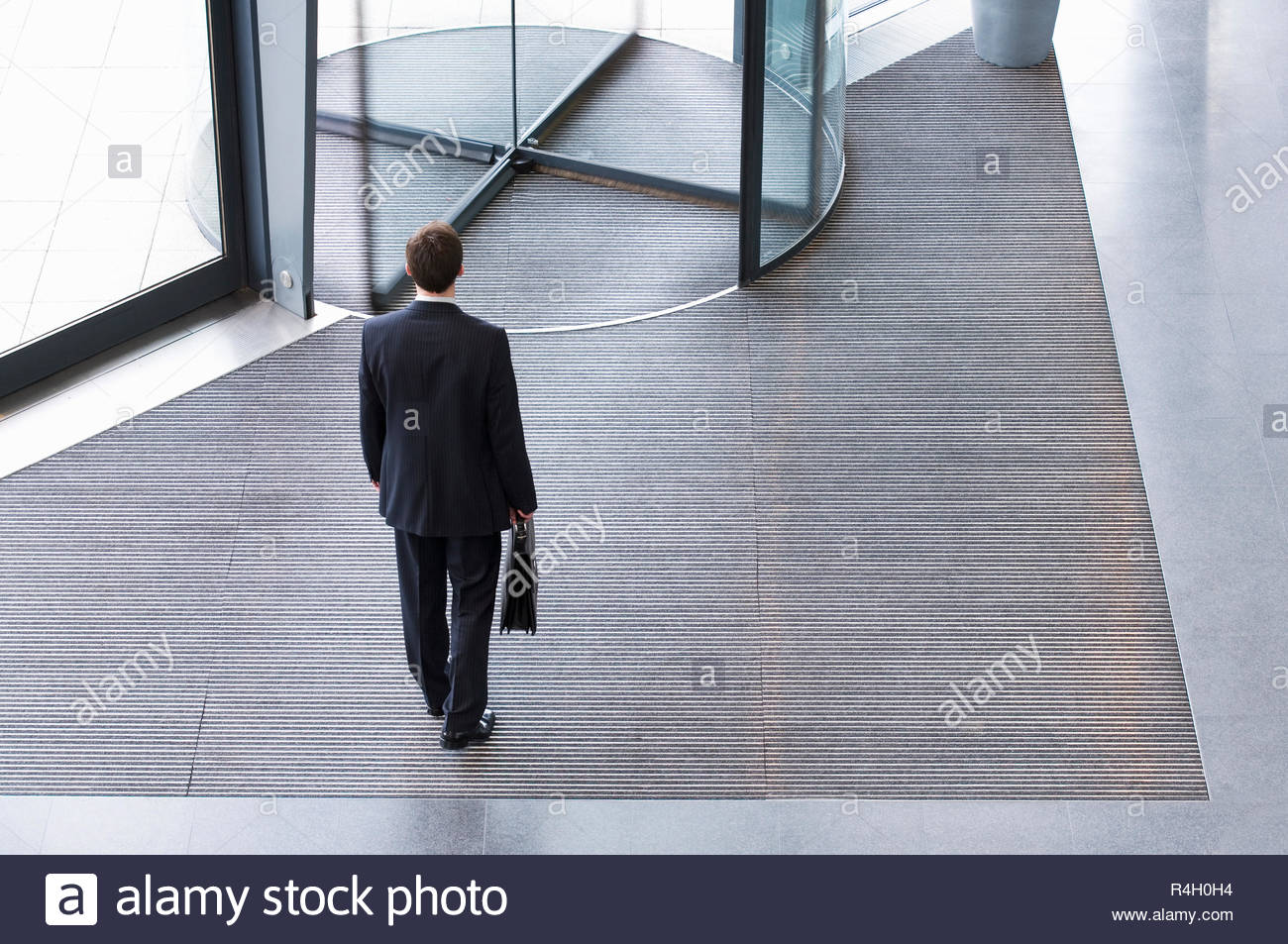 A businessman leaving office - Stock Image