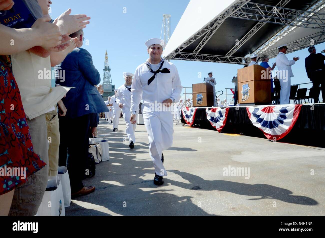 PORT CANAVERAL, Fla. (Sept. 29, 2018) Ms. Diane K. Donald announces 'Bring the Ship to Life' spurring its crew members to race across the brow and fall in formation aboard USS Indiana (SSN 789) during the commissioning ceremony Indiana is the U.S. Navy's 16th Virginia-class fast-attack submarine and the third ship named for the State of Indiana. - Stock Image