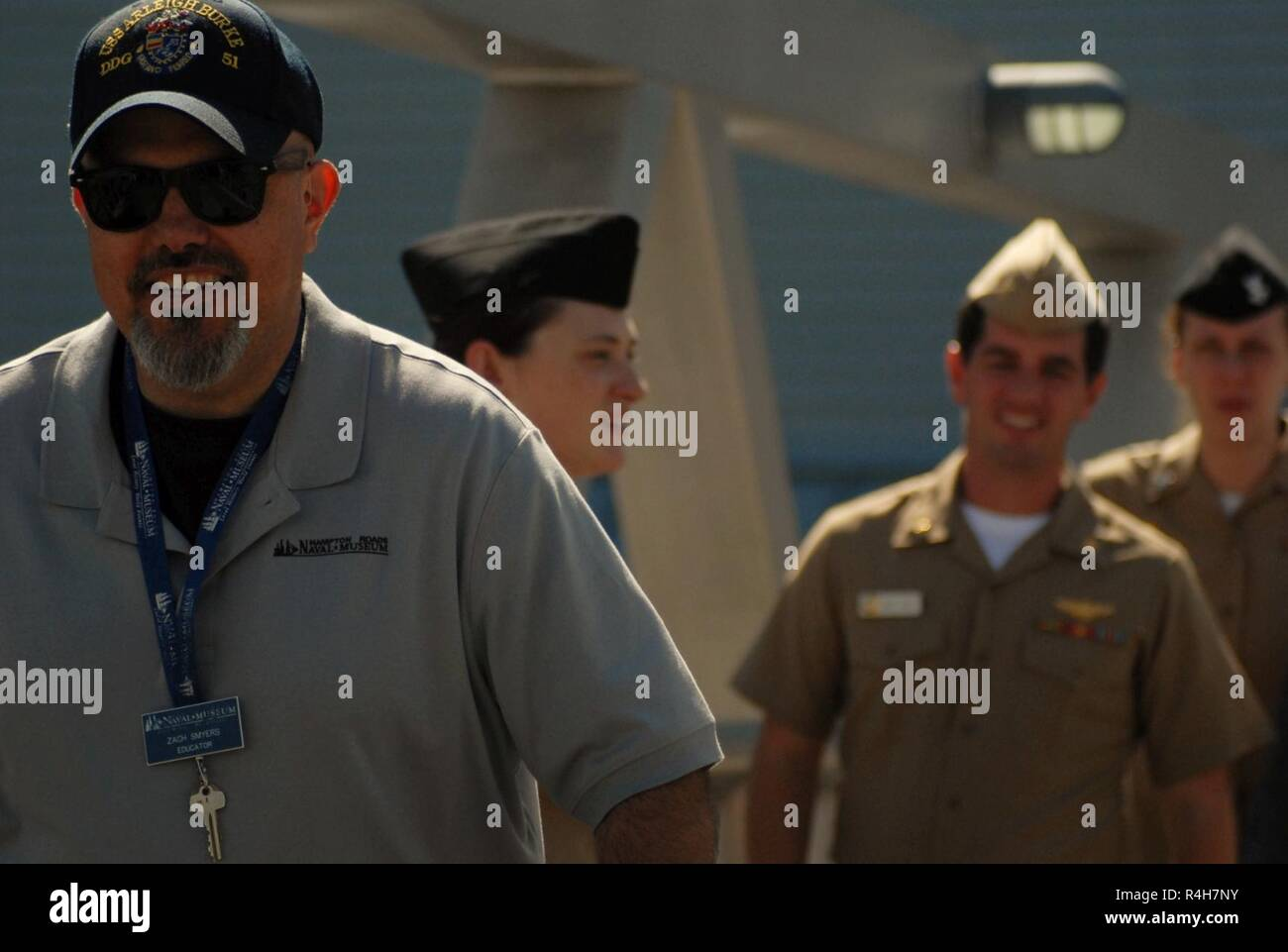 Museum Educator, Zach Smyers (front) escorts the re-enlisting party across  the gangway to the USS Wisconsin (BB-64). STG2(SW) Grace Wells, ...