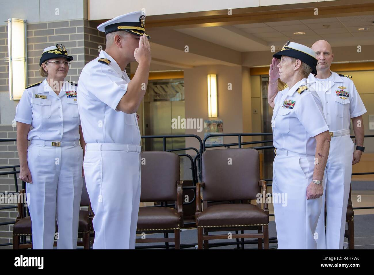 Kathleen A. Hinz, right, assumes command of Naval Health Clinic Patuxent River from Capt. James C. Young, left, during a change of command ceremony held at the Rear Adm. William A. Moffett Building, September 28. - Stock Image