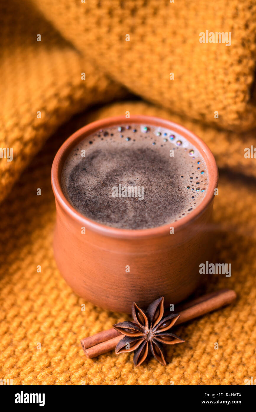 Cup of coffee on the knitted background. - Stock Image