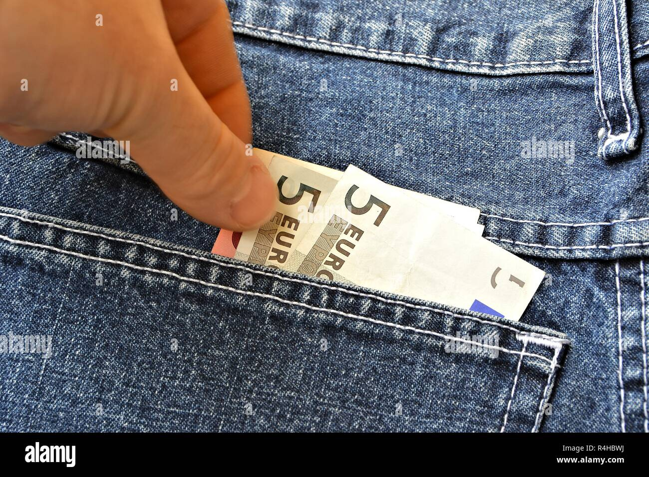 Theft of euro banknotes from a trouser pocket - Stock Image