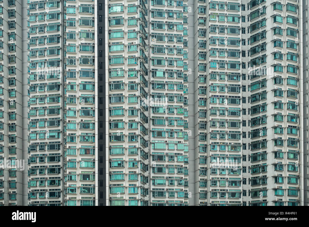 Hong Kong residential apartments block in Tung Chung area. Hong Kong is one of most densely populated city in the world - Stock Image