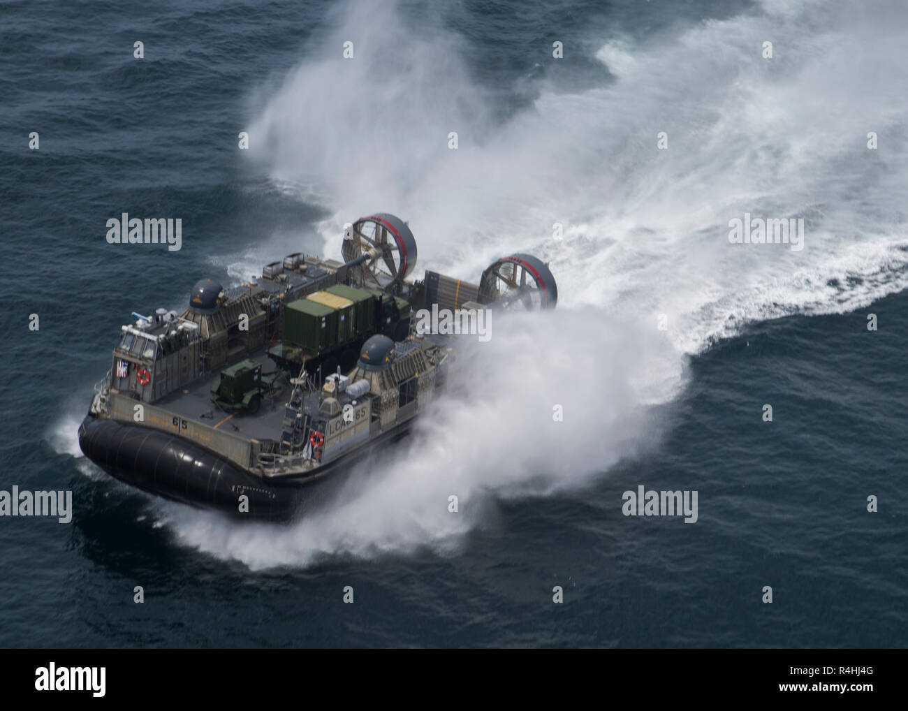 The U.S. Navy Landing Craft, Air Cushioned hovercraft transports Marines and equipment with Special Purpose Marine Air-Ground Task Force - Peru during a humanitarian assistance and disaster relief exercise off of the coast of Chorrillos Beach near Lima, Peru, Nov. 24, 2018.  SPMAGTF-Peru's goal is to demonstrate humanitarian assistance and disaster relief response by bringing together the capabilities of U.S. Marines and sailors aboard the Somerset and Peruvian naval forces as a multinational maritime task force. The integrated mission is part of U.S. Southern Command's Enduring Promise initia Stock Photo