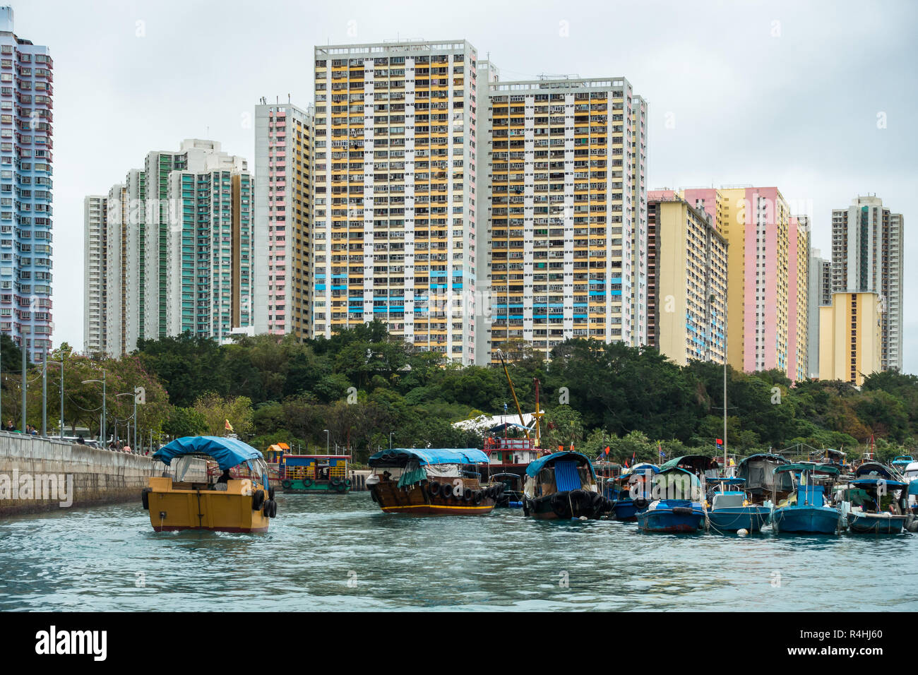 Sampan cruise in Aberdeen harbour, famous for the floating village with old junks and house boats, Hong Kong Stock Photo