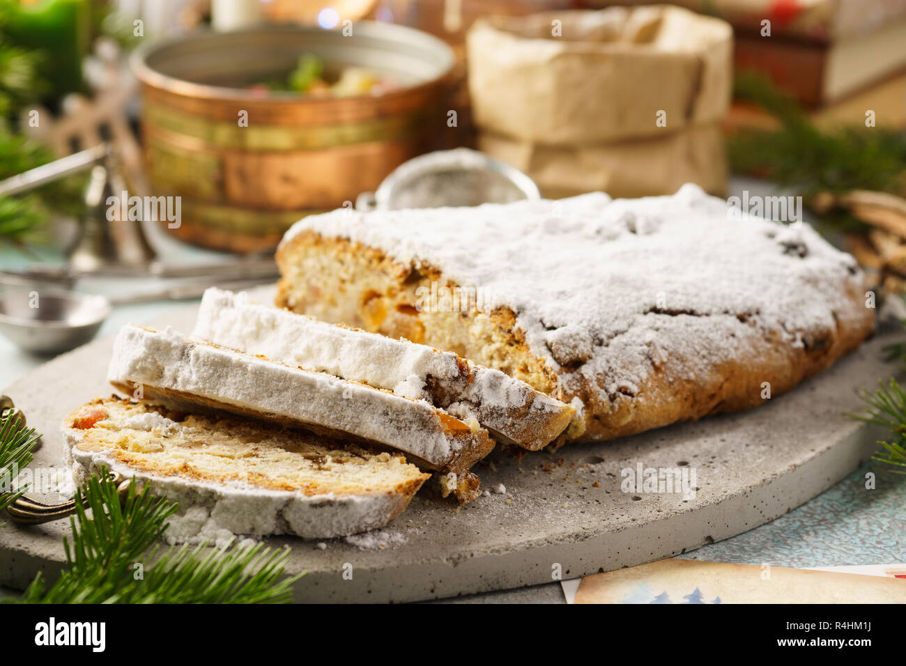 Traditional German stollen, sweet cake with candied fruit and raisins. Christmas sweet gift idea. Selective focus. - Stock Image