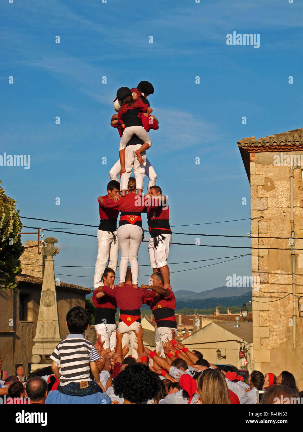castellers building a human tower at a competition in montblanc, catalonia, spain - Stock Image