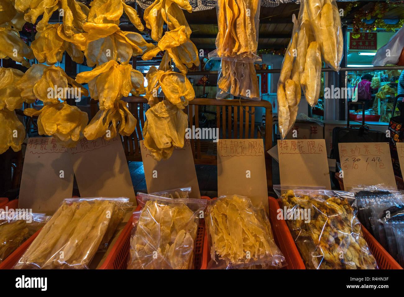 Dried fish for sale at Tai O fishing village, Lantau Island, Hong Kong - Stock Image
