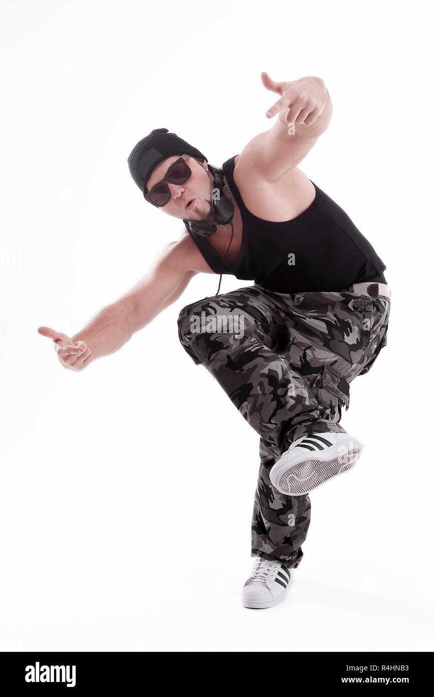 in full growth.Studio portrait of a tough rapper in sunglasses .isolated on white - Stock Image