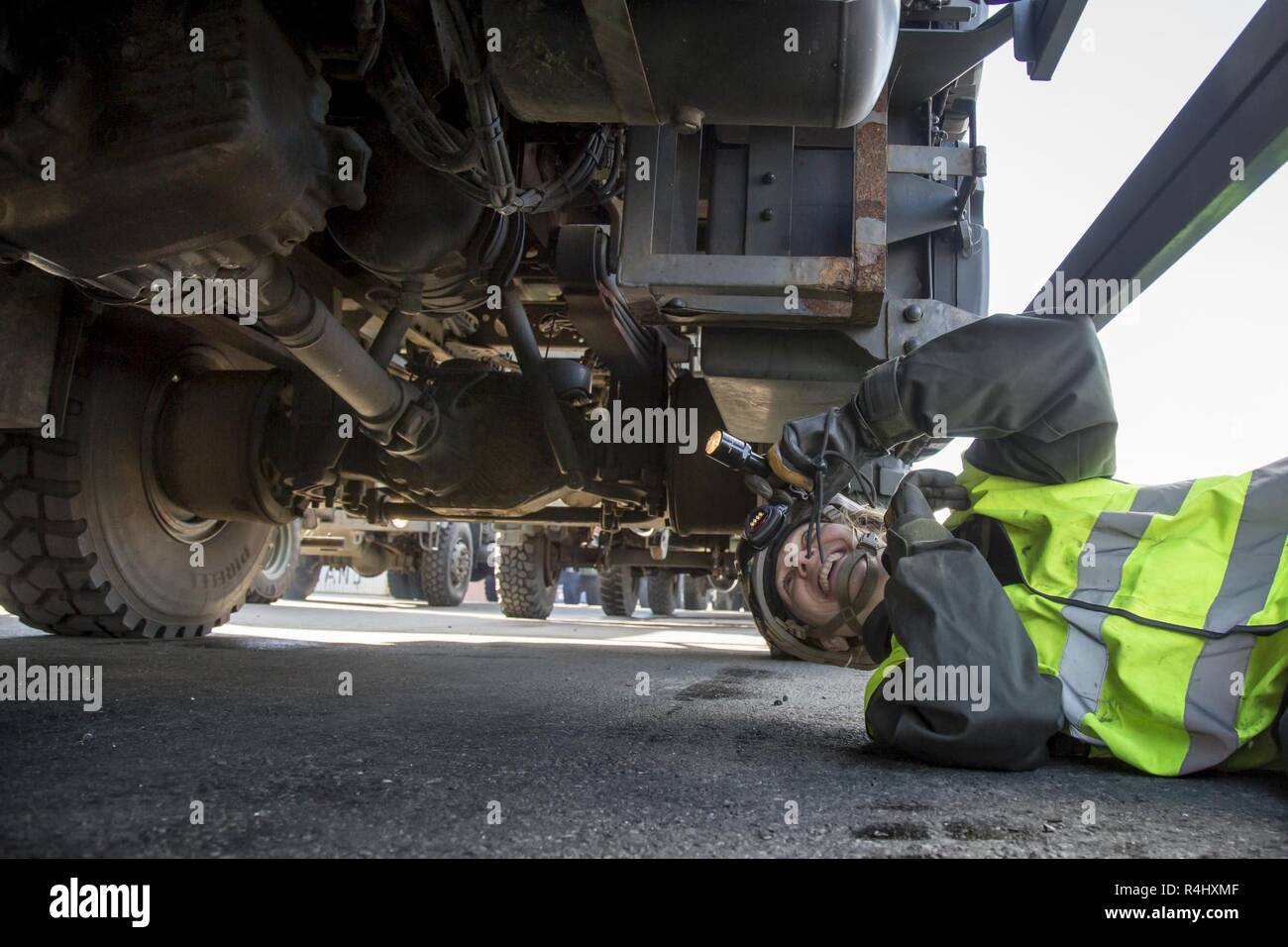 A Norwegian Preventative Medical Technician are checking the vehicles after unloading. Port of Fredrikstad in Norway, NATO exercise Trident Juncture on 28.09.2018. Stock Photo