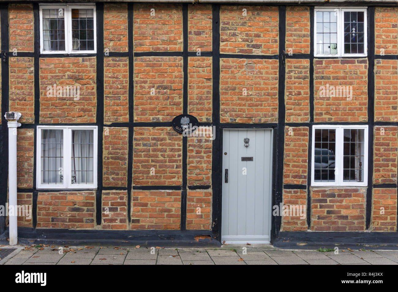 Old Timbers, a half timbered brick built cottage part of a terrace, Well Street, Buckingham, UK - Stock Image